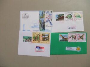 Four covers with DINOSAUR dual stamps:US-Laos,Humgary,GB