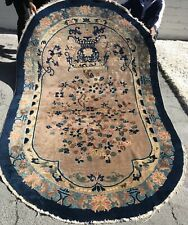 """AN ATTRACTIVE OVAL CHINESE RUG 7'8"""" X 5'"""