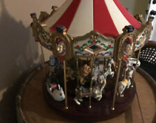 The San Francisco Music Box Company Carousel with 12 horses/rides