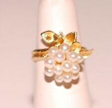 Vintage Pearl Cluster Ring set in 14K yellow gold with Diamond accents