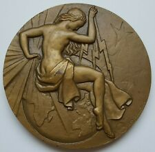 FRANCE - Art Deco Naked Woman with thunderbolt medal by Ray PELLETIER, 68 mm
