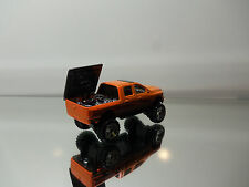 2009 Hot Wheels Dodge Ram 1500 Lifted Pickup Truck - Orange - Mint Loose 1/64