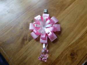 Pram rosette, ribbon, charm