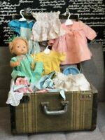 Huge lot of doll clothes (40 +) & 1975 Mattel Hush Lil Baby in a vintage trunk