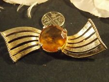 Vintage brooch gold tone with a large amber glass stone