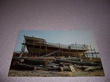 1960s FISHING DRAGGER BOAT UNDER CONSTRUCTION SHELBURNE NOVA SCOTIA VTG POSTCARD
