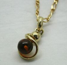 Lovely 10 Carat Gold And Fossilized Amber Pendant And Chain
