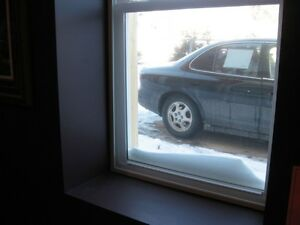 Interior secondary storm windows