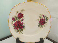 A COLCLOUGH CHINA SIDE PLATE WITH A DEEP RED  ROSE PATTERN