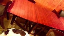 Wooden table with two extension leaves plus four material bottom chairs