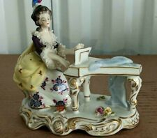 "Antique German Volkstedt Porcelain Figurine, Piano Lady, 4.75"" x 5.25""."