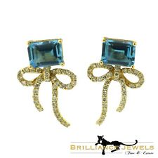 Elegant Blue Topaz and Diamond Bow Tie Ribbon 18k Yellow Gold Earrings