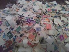 bellissimo lotto di 10000 francobolli mondiali privi di frammento