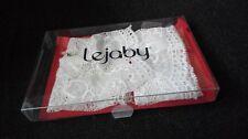 Menottes en dentelle blanche avec chaine attache Swarovsky marque Lejaby