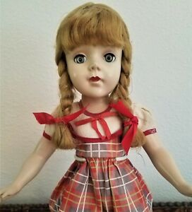 Vintage 1950's hard plastic doll all original, 15 inches, open/close eyes,