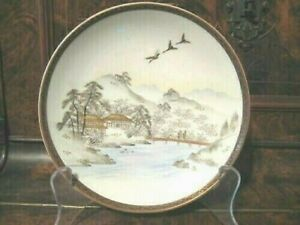 An Early 20th Century Japanese Kutani Plate  hand-painted