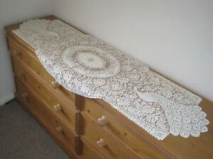 """A LONG LACE RUNNER.  56"""" LONG  x  23"""" WIDE AT WIDEST. PEACOCK DESIGN, CREAM."""