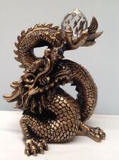 Feng Shui- Golden Dragon holding a crystal ball