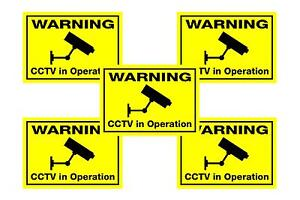 5 x fluorescent dayglo yellow CCTV cameras in operation window warning stickers