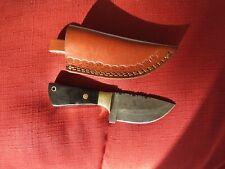 Damascus hunting knife w/black bone stocks & rose rivet with leather sheath