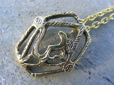 Brass metal om ohm pendant on gold plated chain
