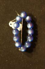 Art Deco blue plastic pin