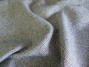 A SUPERB QUALITY UPHOLSTERY FABRIC IN A MODERN WEAVE IN SHADES OF BLUE AND GREY.