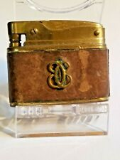 Vintage Buxton Lighter w/ Brown Leather and Emblem in center. Working Condition