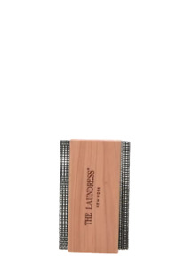 The Laundress Sweater Comb with Two Fine Metal Mesh Screens on a Cedar Wood