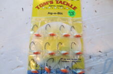 12 Jig-o-bit jigs 1/8 oz. Fishing walleye crappie bass, ice fish,white/orange