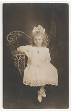 RPPC/Intense Pretty Girl Child/ Poses in Best Dress on Elaborate Wicker Chair