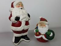 Lot Of 2 ceramic Santa Claus figurines one is a candle holder