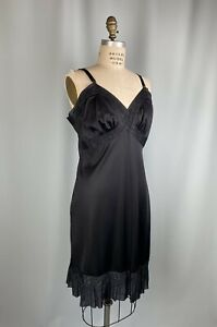 circa 1960 Vintage black full slip