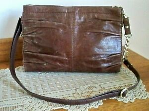 The SAK Iris Demi Chocolate Brown Distressed Shoulder Crossbody Clutch Handbag