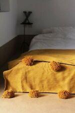 Solid mustard color,  Moroccan pompom blanket