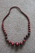 Long graduating wood bead necklace Good condition.