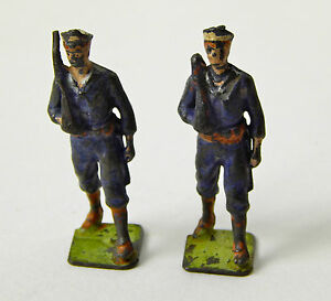 Vintage Pair of Cast Iron Painted soldiers made in London England fair condition