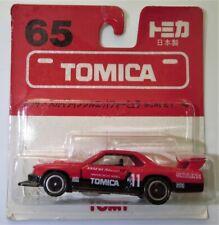 Tomica Nissan Skyline Silhouette Formula #65 on card (1995)