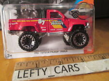 HOTWHEELS 1987 Red TOYOTA PICK UP TRUCK SCALE 1/64 - ON LONG CARD