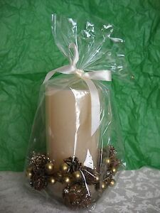 LARGE CHRISTMAS CANDLE WHITE W/GLITTERY GOLDEN PINE CONE AND BERRY WREATH