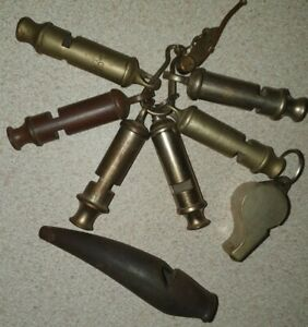 JOB LOT OF MIXED WHISTLES POLICE MILITARY SCOUTS AND A WOODEN TRENCH WHISTLE?