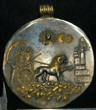 An ancient Round Silver pendant with Greek warriors on a chariot.