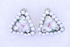 White and pink centre rose earrings. Surrounded by crystals and tiny pearls