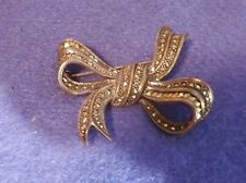 Sparkling marcasite and silver bow shaped brooch 0.5 oz