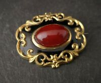 Victorian gilt and black enamel brooch, red stone, mourning stylr