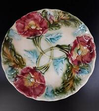 Assiette en barbotine décor fleuri