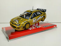 Slot car Scalextric SCX A10050X300 Subaru Impreza #7 WRC McRAE