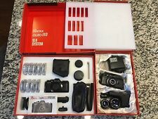Pentax Auto 110 SLR Two Boxed sets. Two Cameras, winders, flashes, Six lenses.
