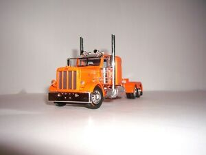DCP FIRST GEAR 1/64 ORANGE PETERBILT 389 WITH 36'' FLATTOP SLEEPER
