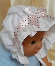 BABY GIRL SUN BONNET. WHITE & RED POLKA DOTS 0-6 MONTHS